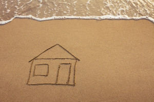 House outline about to be washed away on the beach