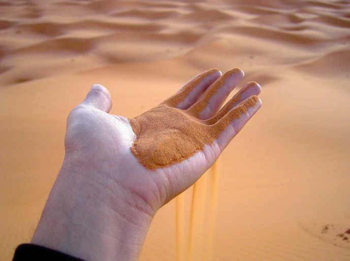 Hand with sand in Morocco