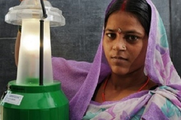 Woman with solar lamp in India